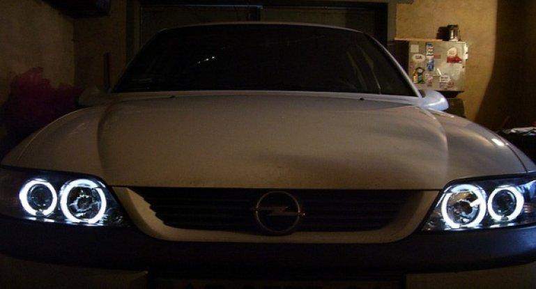 Замена лампы ближнего света Opel Astra H, G, J и Vectra A, B: тюнинг и регулировка фар, реснички